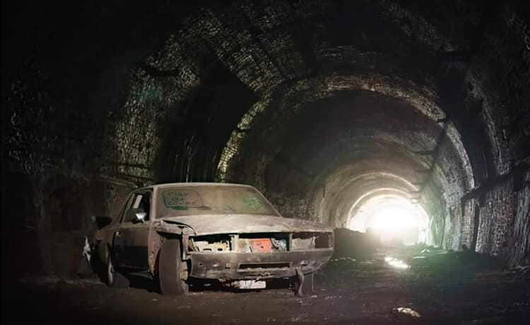 Fiat 130 in old railway tunnel